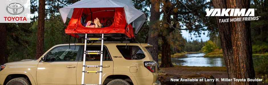 A family in a Yakima Tent on top of a Toyota 4Runner