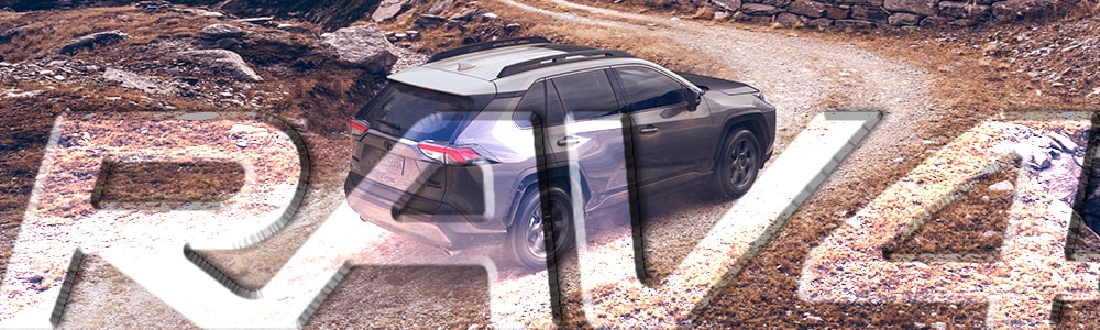 A new gray 2018 Toyota Rav4 driving on a gravel road