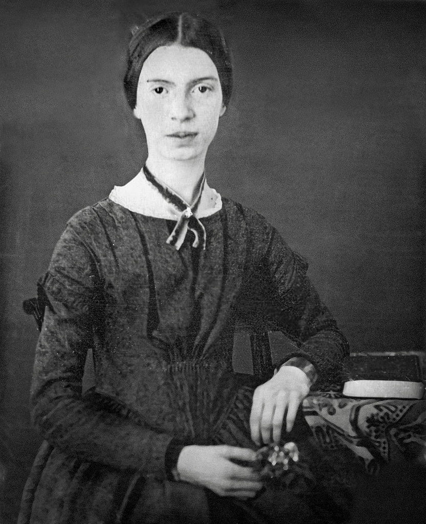 Emily Dickinson posing for a portait in her home