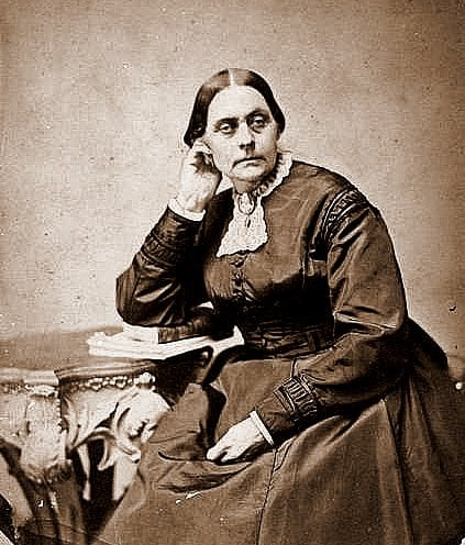 A younger Susan B Anthony as she sits at her desk and reads a novel