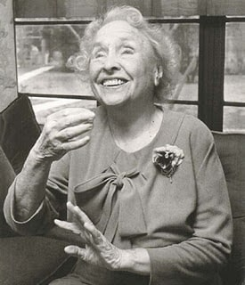 An older Hellen Keller showing a big smile to the camera