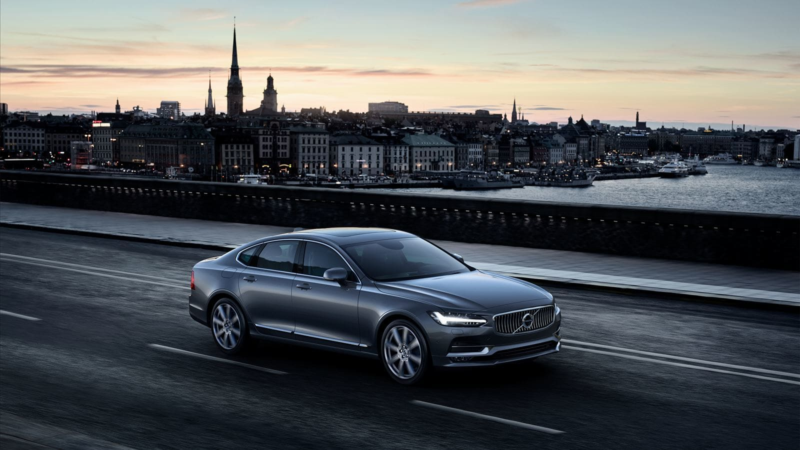 2018 Volvo S90 driving at sunset