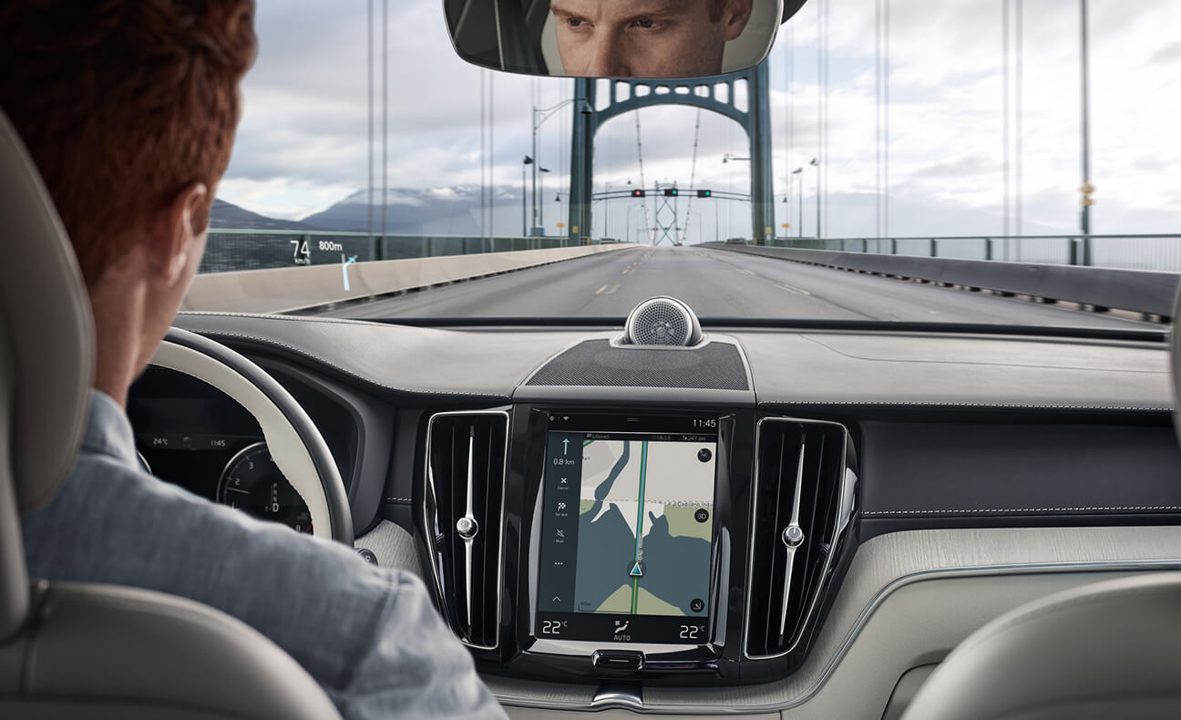 2018 Volvo XC60 driving down highway bridge