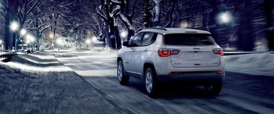 2019 Jeep Compass driving through snow