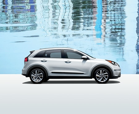 White Kia Niro on blue background