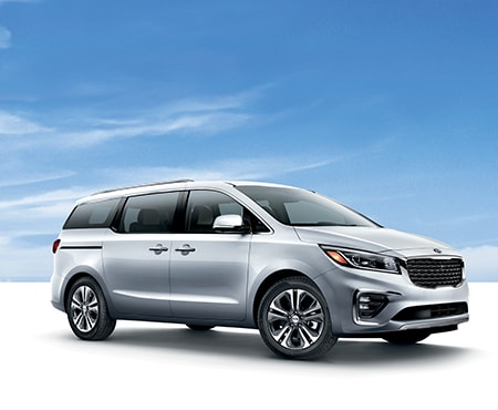 White Kia Sedona on blue background