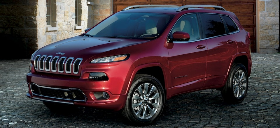 A maroon 2019 Jeep Cherokee parked in a driveway