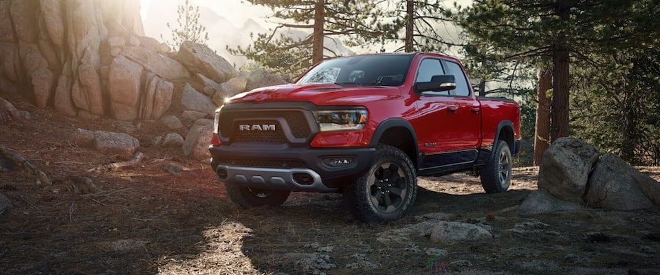A 2019 Ram 1500 Rebel parked in the woods