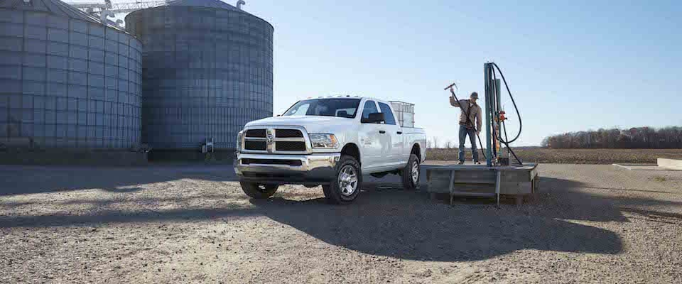 A man filling up equipment on his 2019 Ram 2500