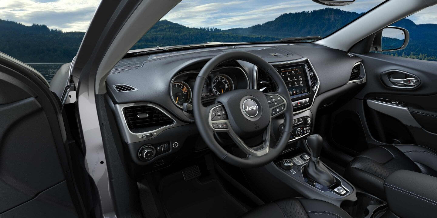 Picture of 2019 Jeep Cherokee interior seats against a mountanous backdrop