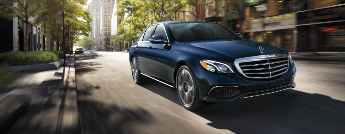 The Mercedes-Benz E-Class Sedan driving on a city street