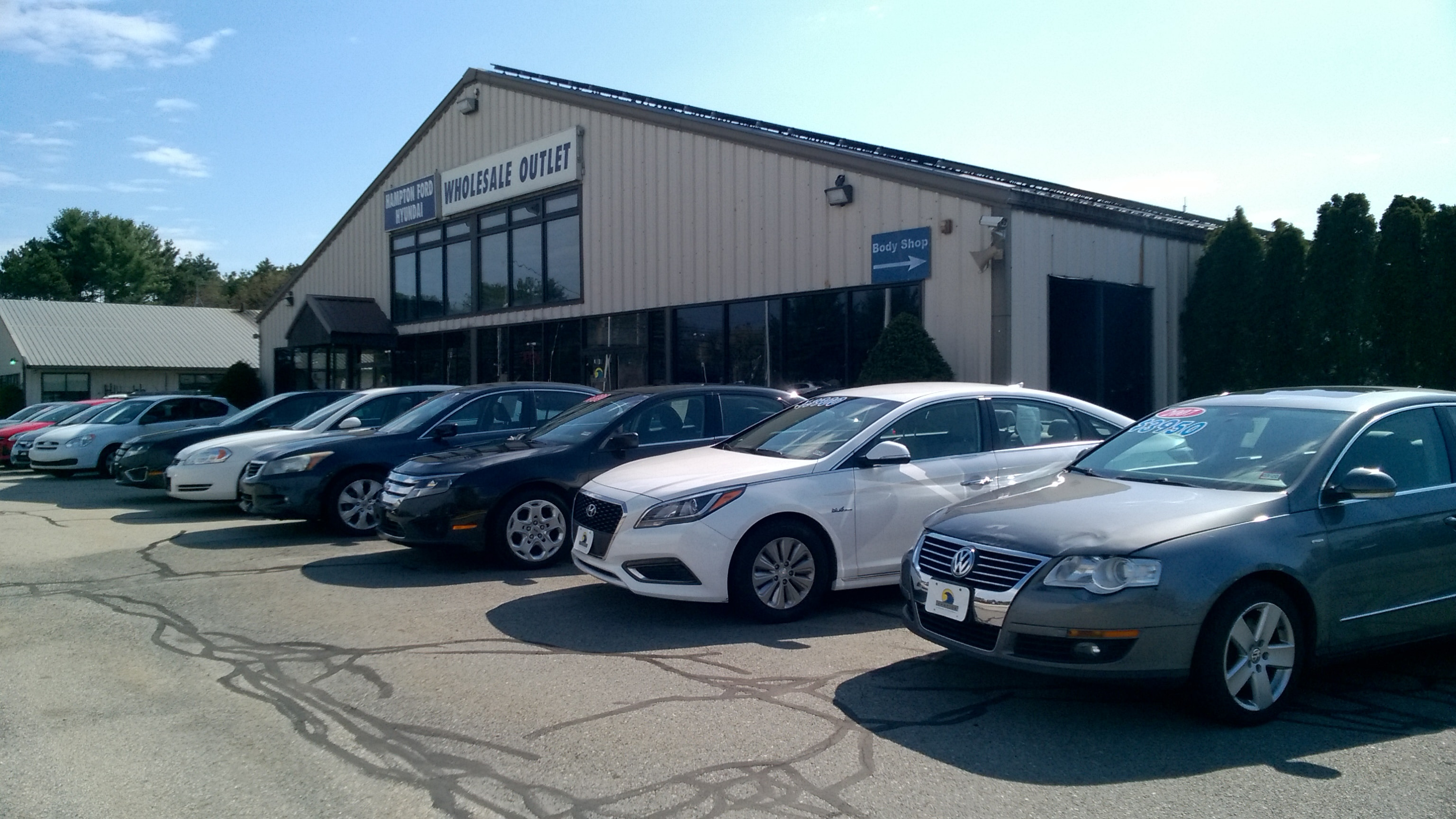 Hampton Ford Hyundai Wholesale Outlet Front of Building with Selection of Wholesale Vehicle Inventory
