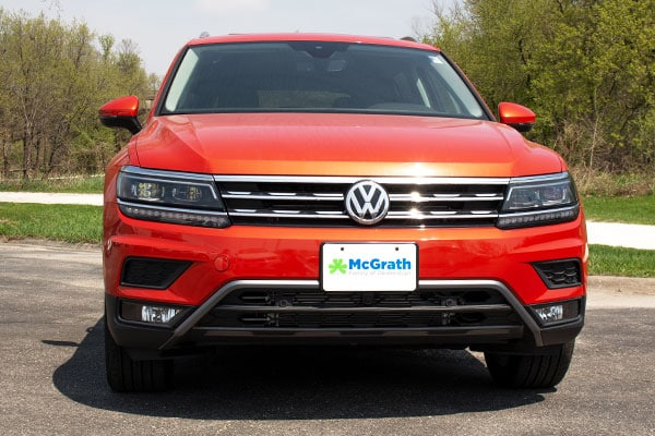 2019 Metallic Orange VW Tiguan driving in the mountains