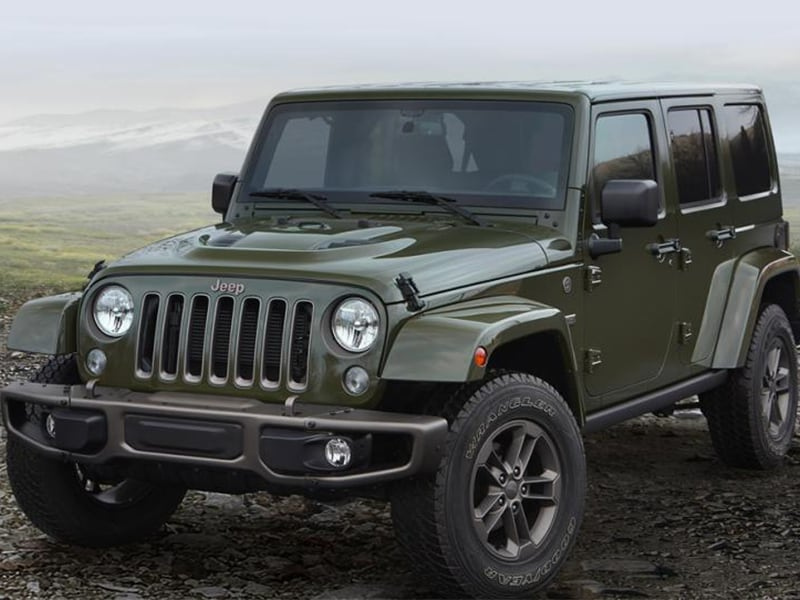 2016 Jeep Wrangler Unlimited parked in an open field