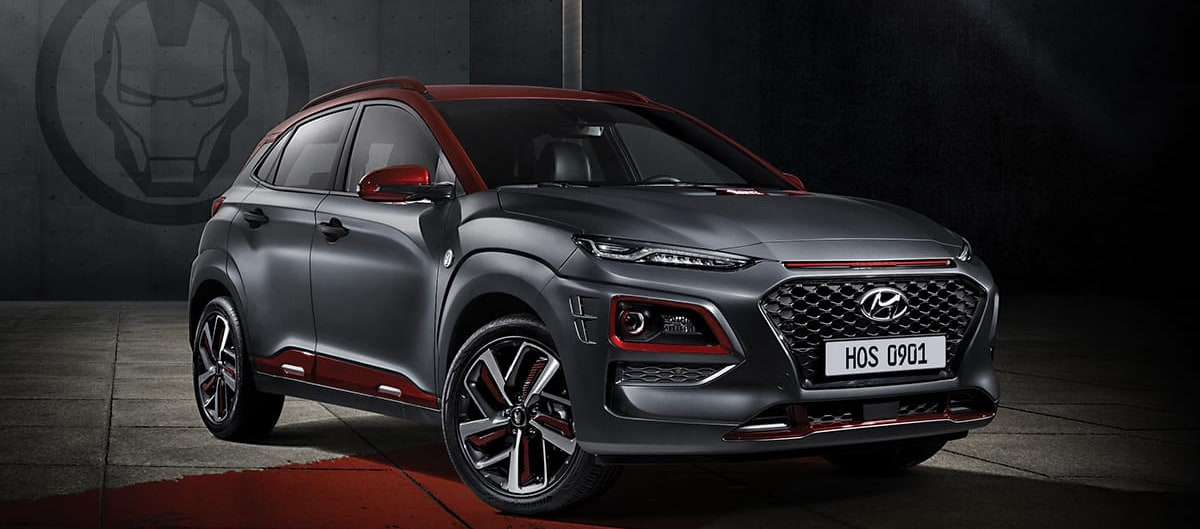 2019 Hyundai Kona Ironman Edition Gray and Ironman Red Exterior parked in a warehouse