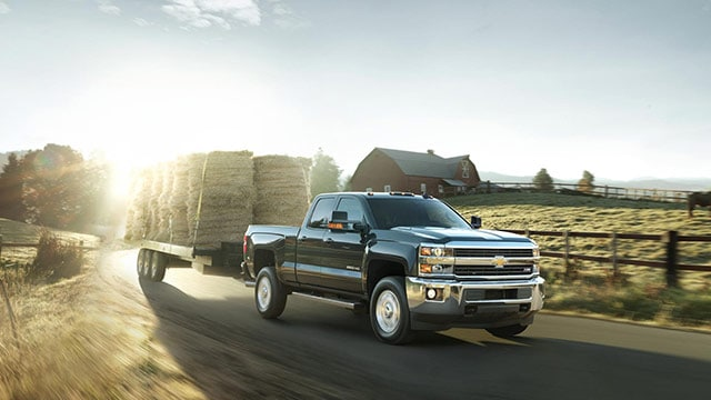 Used Chevy Silverado HD in Cedar Hauling Hay