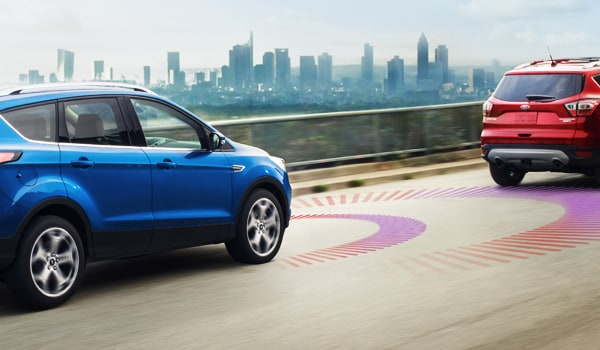 2019 Ford Escape driving down the road demonstrating adaptive cruise control