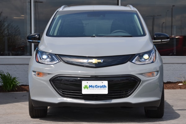 2019 Silver Chevy Bolt parked in front of a buidling
