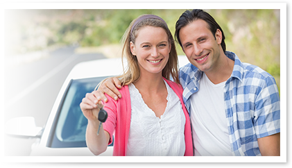 Couple holding car keys