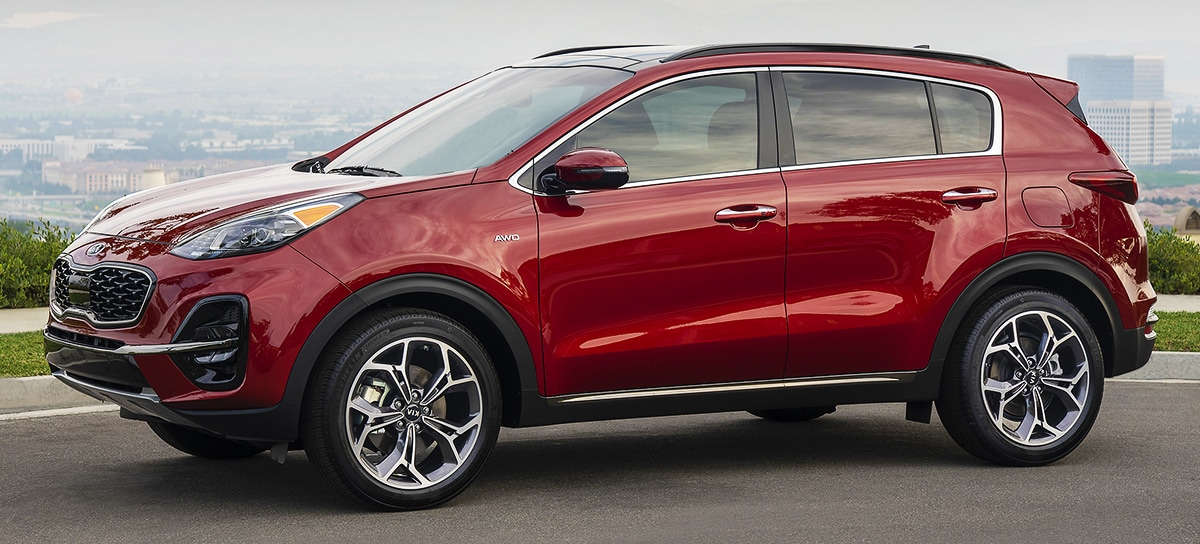 2020 Red Kia Sportage Exterior Parked on a hill top overlooking a city
