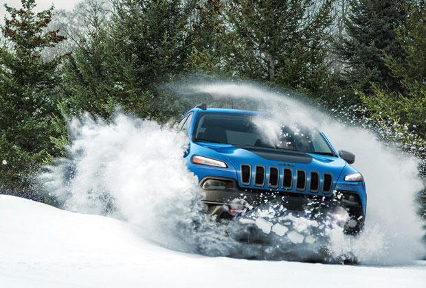 Jeep Cherokee driving through snow