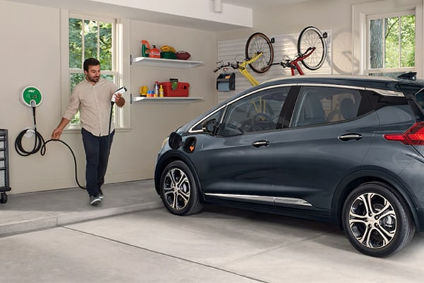 2019 Chevy Bolt in a garage charging