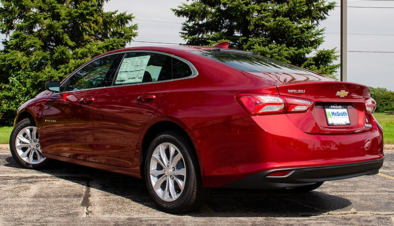 2019 Cajun Red Chevy Malibu LT rear exterior parked in a lot
