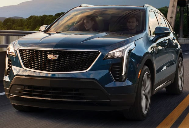 blue 2019 cadillac xt4 driving