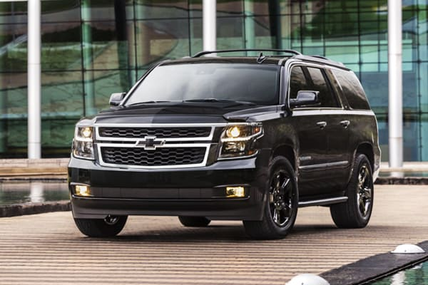 2019 Blacked Out Chevy Suburban Parked near buildings