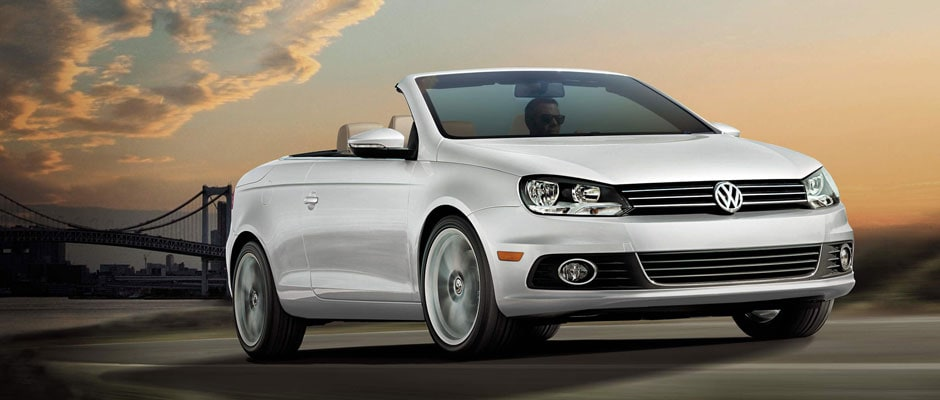 Volkswagen EOS driving down the street