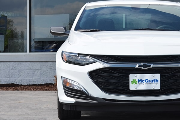2019 white Chevy Malibu parked front grille and headlights