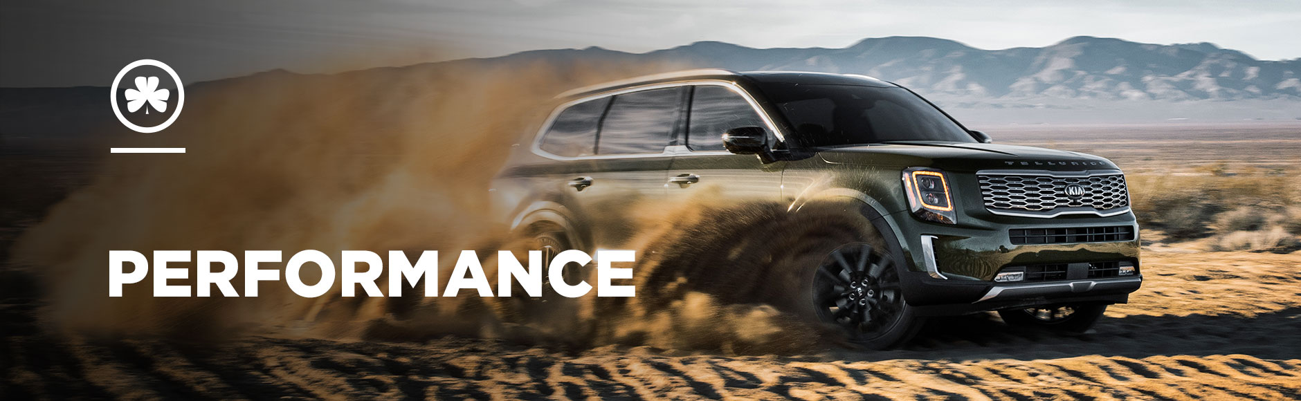 Kia Telluride Performance Banner - spinning out in sand