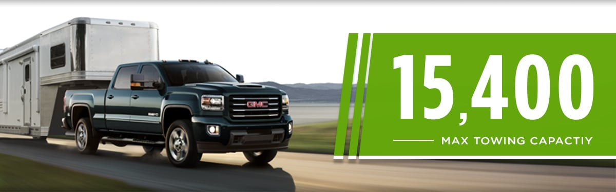 2019 GMC Sierra 2500HD Towing large trailer in the countryside