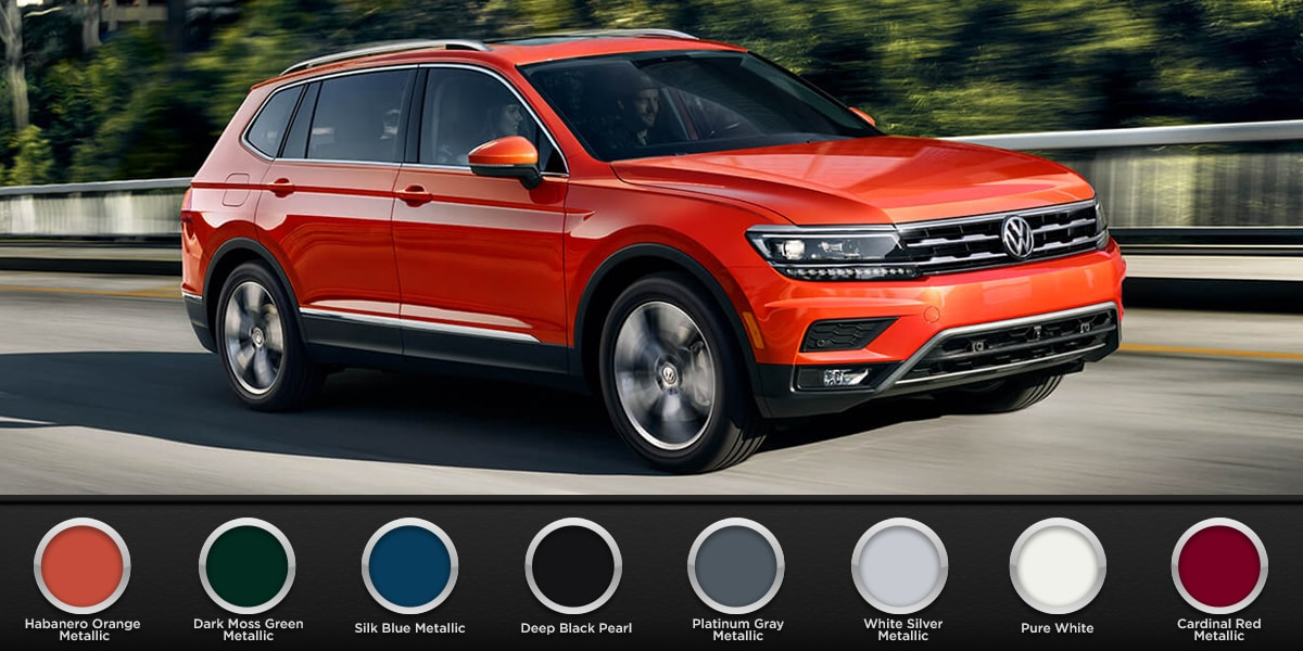 2019 Metallic Orange Volkswagen Tiguan driving down the road with all color schemes available