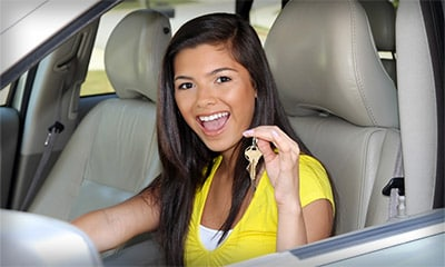 Young teen driver holding car keys