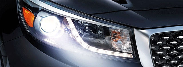 Blue Kia Sedona LED headlights