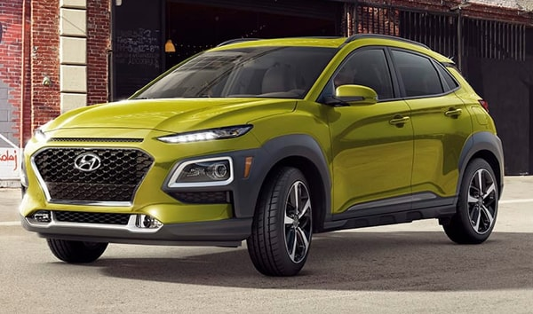 2019 Sunset Orange Hyundai Kona Limited Parked