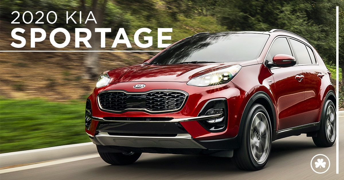 2020 Red Kia Sportage Driving down the road