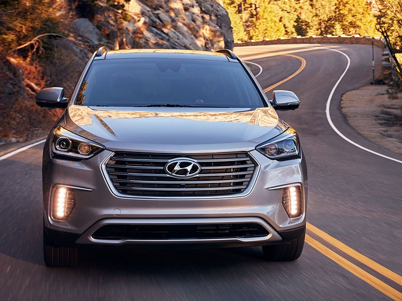 2017 Hyundai Santa Fe driving through the hills