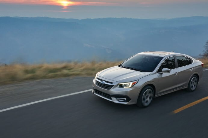 2020 Subaru legacy Driving on High Way With Sun Set