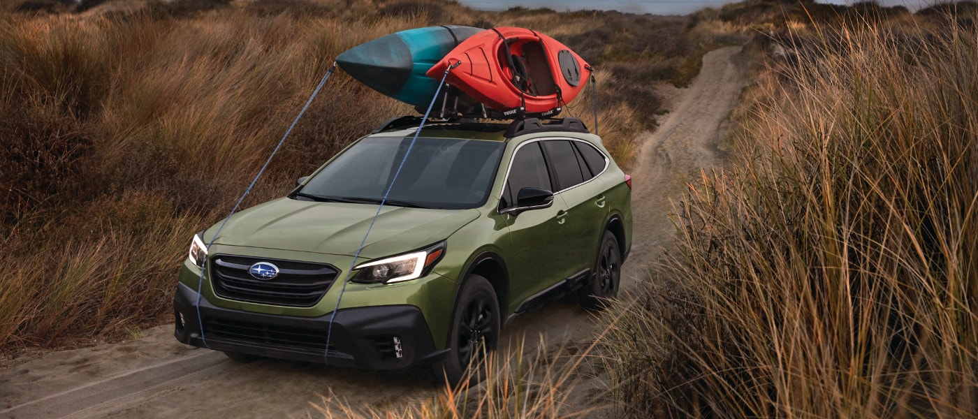 Green 2020 Subaru Outback Onyx Turbo in field