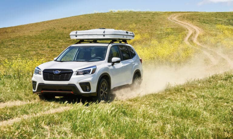 2021 Subaru Forester exterior offroad in green field