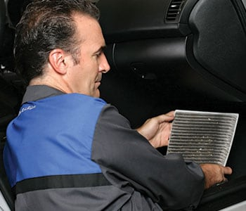 Subaru Technician replacing cabin air filter