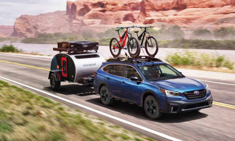 2021 Subaru Outback towing a trailer on the highway