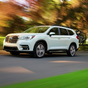 White Subaru Ascent on road