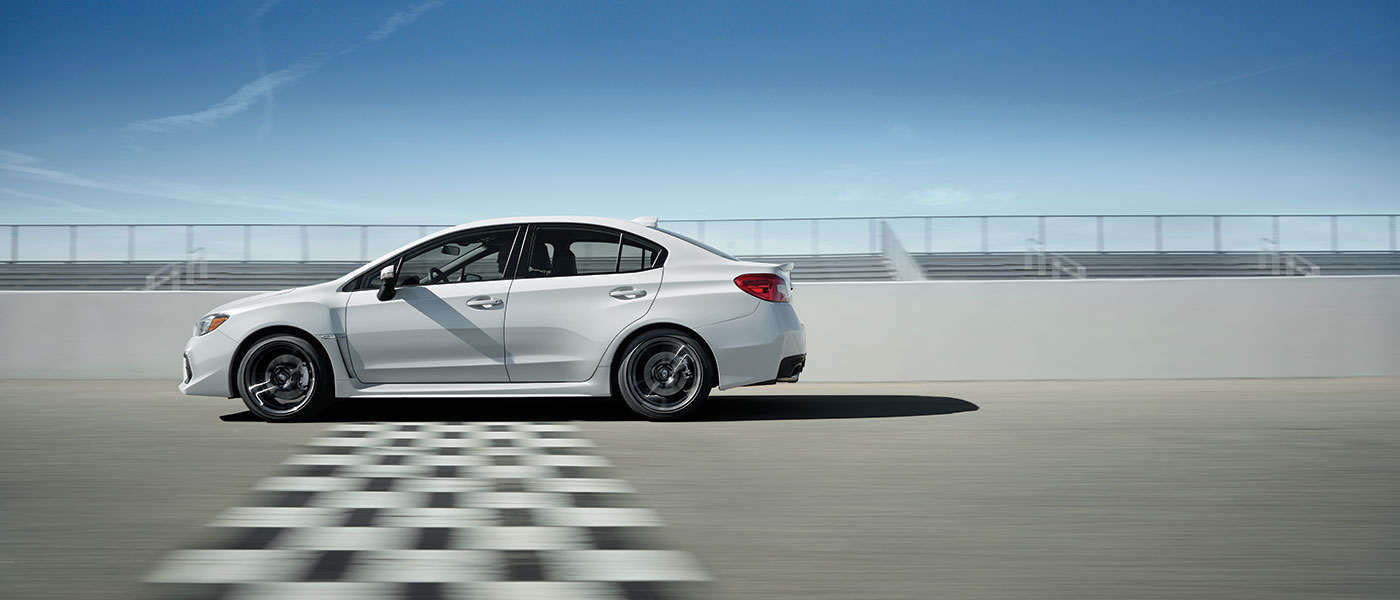 White 2019 Subaru WRX exterior side view crossing finish line