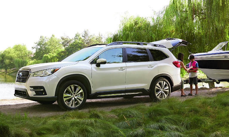 White Subaru Ascent near lake