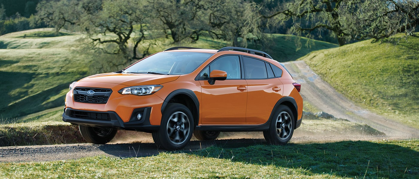 Orange 2019 Subaru Crosstrek 2.0i exterior view on grass