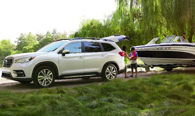 White Subaru Ascent towing boat