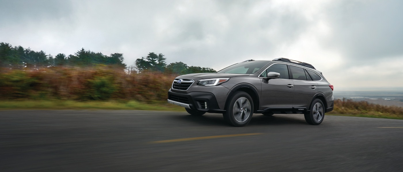 Gray 2020 Subaru Outback Touring on road
